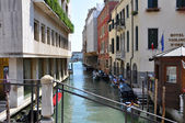 VENICE-JUNE 15: Narrow Venetian canal on June 15, 2012 in Venice, Italy. — Stock Photo
