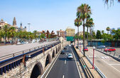BARCELONA-JULY 25: Barcelona's street and seafront on July 25, 2013 in Barcelona. Catalonia, Spain. — Stock Photo