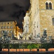 FLORENCE-NOVEMBER 11:Fountain of Neptune on Piazza della Signoria at night on November 11,2010 in Florence,Italy. The Fountain of Neptune is a fountain in Florence, Italy, next to the Palazzo Vecchio. — Stock Photo