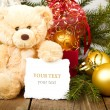 Seated teddy bear with gift — Stock Photo