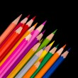 Colour pencils isolated on black background close up — Stock Photo