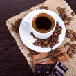 Cup of coffee with beans — Stock Photo