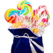 Colorful candies on white background — Stock Photo