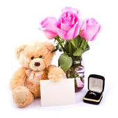 Teddy Bear and flowers — Stock Photo