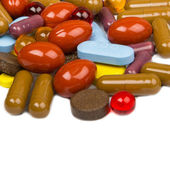 Close up of colorful tablets and capsules — Stock Photo