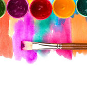 Art studio paints, palette, brush — Stock Photo