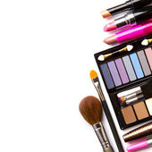 Makeup brush and cosmetics, on a white background isolated, with — Foto Stock