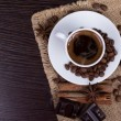 Cup of coffee with beans — Stock Photo #21593117