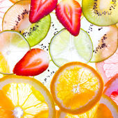 Sliced fruits background — Foto Stock