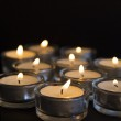 Panorama of the many burning candles with shallow depth of field — Stock Photo