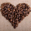 Stock Photo: Heart made of coffee beans on burlap sack