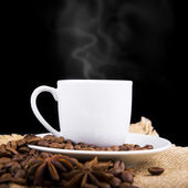 Cup of hot drink with coffee beam's — Stock Photo