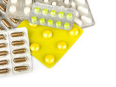 Capsules and pills packed in blisters isolated on white close-up — Stock Photo