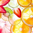 Sliced fruits background — Stock Photo #24276613