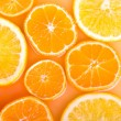 Abstract background with citrus-fruit of orange and tangerine sl — Stock Photo