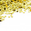 Stars confetti , side of the yellow small stars isolated on whit — Stock Photo