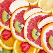 Sliced fruits background — Stock Photo