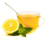 Tea in cup with leaf mint and lemon isolated on white background — Stock Photo