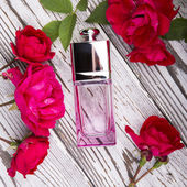 Perfume in beautiful bottle with rose — Stock Photo
