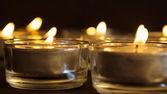 Grupo de velas encendidas sobre fondo negro — Foto de Stock