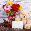 Teddy Bear and flowers — Stock Photo #36038609
