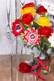 Beautiful flower bouquet on wooden table — Stock Photo