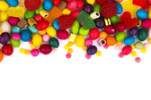 Mixed colorful candies isolated on white — Stock Photo