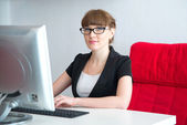A girl in the office — Stock Photo