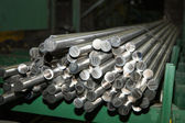 Polished titanium and aluminum rods and pipes — Stock Photo