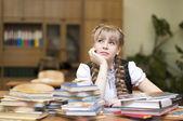 Schoolgirl with textbooks — Stock Photo
