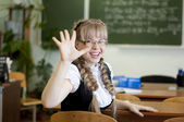Schoolgirl on board background — Stock Photo