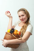 Blonde with harvest fruit — Stock Photo