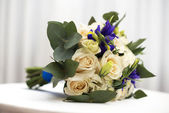 Bridal bouquet of roses of irises — Stock Photo