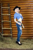 Blonde in western style — Stock Photo