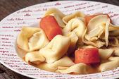 Tortellini in broth — Stock Photo