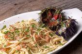 Spaghetti with sea urchins — Stock Photo