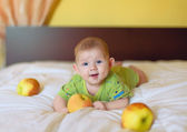 Baby boy holding yellow apple — Stock Photo