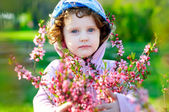 Beautiful girl with flowers of almonds — Stok fotoğraf