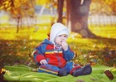 Little baby in the autumn park — Stock Photo