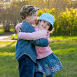 Small boy and the girl walk and embrace in park — Stock Photo
