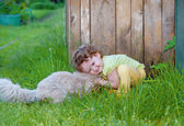 Little curly girl kissing cat — Stock Photo