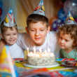 Children celebrate a birthday  in Cars hats — Stock Photo