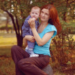 Mother with baby in the park — Stock Photo #18324557