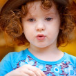 Portrait of a beautiful little girl on a yellow background — Stock Photo #18488495
