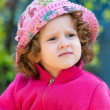Curly little lady in the pink hat — Stock Photo