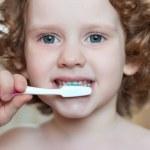 Portrait of the little girl brushing her teeth — Stock Photo #18709453