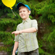 Boy playing with an inflatable balloon — Stock Photo #19104439