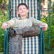 Boy is resting in a deckchair — Stock Photo