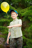 Boy playing with an inflatable balloon — Stock Photo