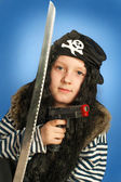 Pirate boy with gun and sword. Halloween finery. — Stock Photo